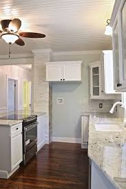 cabinets painted bm simply white wall behind island is