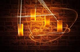 yellow string lights on brown brick
