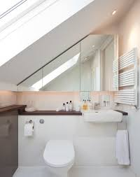 exquisite contemporary bathroom sloped ceiling decoratively heated towel rail paired wooden bathroom counter paired small space