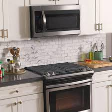 kitchen tile. a patterned tile over the range to creates dynamic focal point for your kitchen. kitchen t