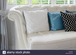 white leather couches with pillows. Fine Couches White And Blue Pillows On A Leather Couch In Vintage Living Room Inside White Leather Couches With Pillows O