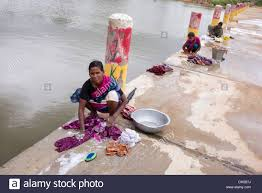 woman washing clothes by hand. Modren Hand Indian Women Washing Clothes By Hand Next To A River Andhra Pradesh India   In Woman Washing Clothes By Hand M