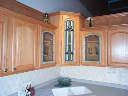 furniture brown stained wood kitchen cabinet with accent glass door