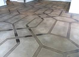 how to tile a concrete floor brown ribbon border pattern on concrete floor laying tile over