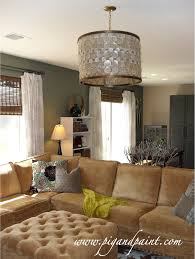 wonderful capiz shell chandelier in drum design hanged above the sofa set and ottoman for living