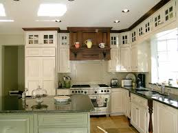 Maple Kitchen Furniture A Country Kitchen In Pale Green With A Small Preparation Island In
