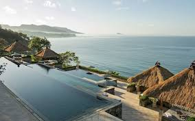 Amankila's spectacular centrepiece is the three-tiered swimming pool, which  steps down the hillside echoing Bali's cascading rice fields.