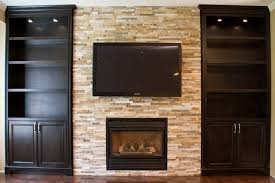 glass shelves built in units around fireplacetraditional living room toronto