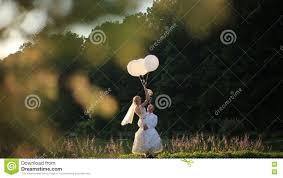 sensual moment of love happy groom carryes in hands beautiful blonde bride with balloons sunny summer field background stock video video of green