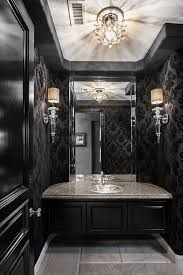 a crystal ceiling light like the quoizel bordeaux makes this dramatic goth powder room shine