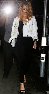 rihanna s switzerland acne road petite white leather jacket and black azzedine alaia jumpsuit