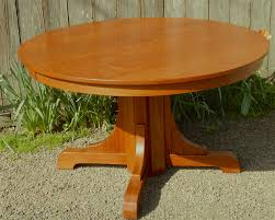 gustav stickley vintage pedestal base dining table with excellent grain on the top