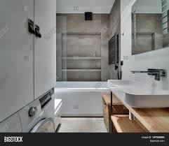 Bathroom In Modern Style With Textured Tiles White Sink With Tap - Bathroom locker
