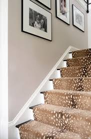 love the antelope runner home tour a preppy connecticut house with ladylike details chic zebra print rug