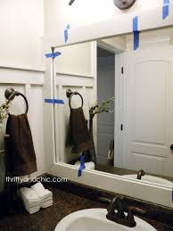 Thrifty And Chic DIY Projects And Home Decor - Trim around bathroom mirror