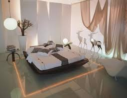 stunning bedroom design with white wall diffe and soft brown hanging curtain beside white lounge chair