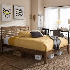mid century bedroom ideas with seagrass rug and wooden modern queen bed frame with yellow bedding