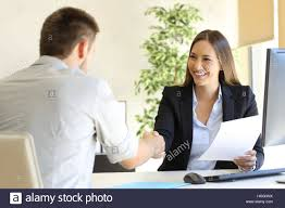successful job interview boss and employee handshaking stock stock photo successful job interview boss and employee handshaking