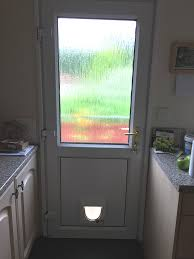 bottom door panel with old cat flap that needs removing and replacement sealed unit to be