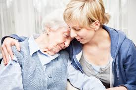 home care services in charlotte nc home caregiver consoling sad senior w