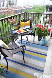 diy outdoor rug looks amazing on the balcony