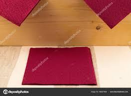 Light Burgundy Color Background Consisting Surface Wooden Board Paper Napkins