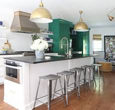 green white kitchen black granite
