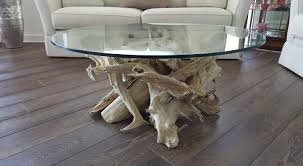 driftwood coffee table oval base 1375 00 oval glass top 45 x 32 3 4 thickness 450 00