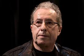 Peter James. Over the course of the Roy Grace series, the mysterious disappearance of his wife, Sandy has always been there as a reminder to us of his ... - 800px-Peter_James_20100330_Salon_du_livre_de_Paris_2