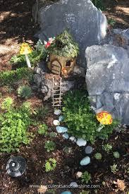 this outdoor succulent fairy garden is adorable