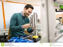 Mechanical Engineer Working On Machines Stock Photo Image