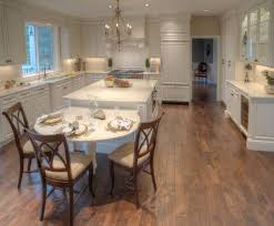 ... kitchen island with a long wooden table on the side View in gallery ...