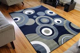 modern sofa set and navy blue area rug with wood floorings