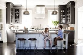 Best kitchen lighting Recessed Children Eating Popsicles In Kitchen The Spruce The Best Kitchen Lights For 2019