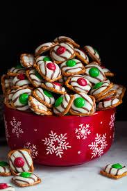 pretzel m m hugs in a red snowflake bowl the consist of square pretzel base