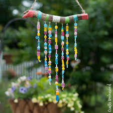 So how fun is this DIY wind chimes for kids craft?!? I LOVE all the bright  colors. It will totally make a statement in the yard this Summer and the  kids can ...