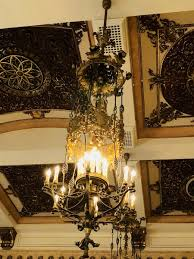 these imperial chandeliers are stunning boasting spidery legs heraldic elements that look like crests and intricate fl cups