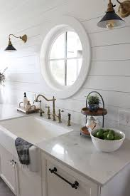 shiplap kitchen planked walls behind sink stove