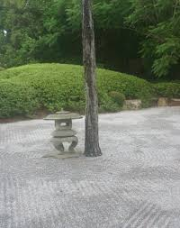 this early waterless or dry japanese garden already has the patterned raked stones of