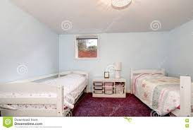 Pale Bedroom Pale Blue Walls And Burgundy Carpet Of Kids Bedroom Stock Photo