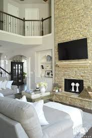 living room with stone fireplace with tv. Decorating Two Story Living Room Above Fireplace Great With Stacked Stone Tv U