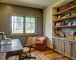 rustic office design. inspiration for a rustic freestanding desk medium tone wood floor home office remodel in denver with design r