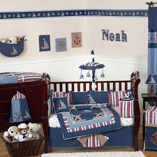 contemporary nautical themed nursery bedding ideas with navy blue nautical decorative throw pillow and baby name