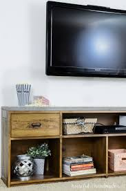 Televison Mounted On The Wall Above A Warm Brown Rustic TV Stand With  Concrete Top Industrial Tv98