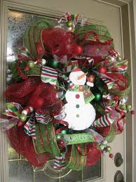 bow front door wreath and snowman