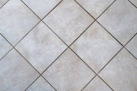 cleaning the grout between natural stone tiles