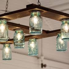 The couple created their own impressive DIY light fixture out of Mason  jars, cafe lights