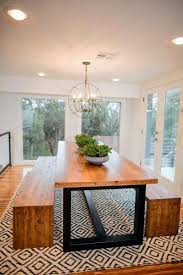 the dining room features a table custom made by clint harp the table s design features