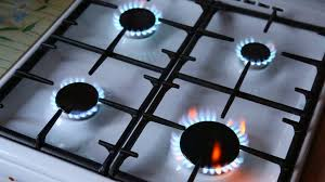 Natural gas inflammation in stove burner close up view Stove top