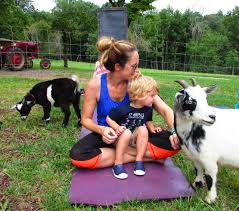 folks try yoga with baby goats mt